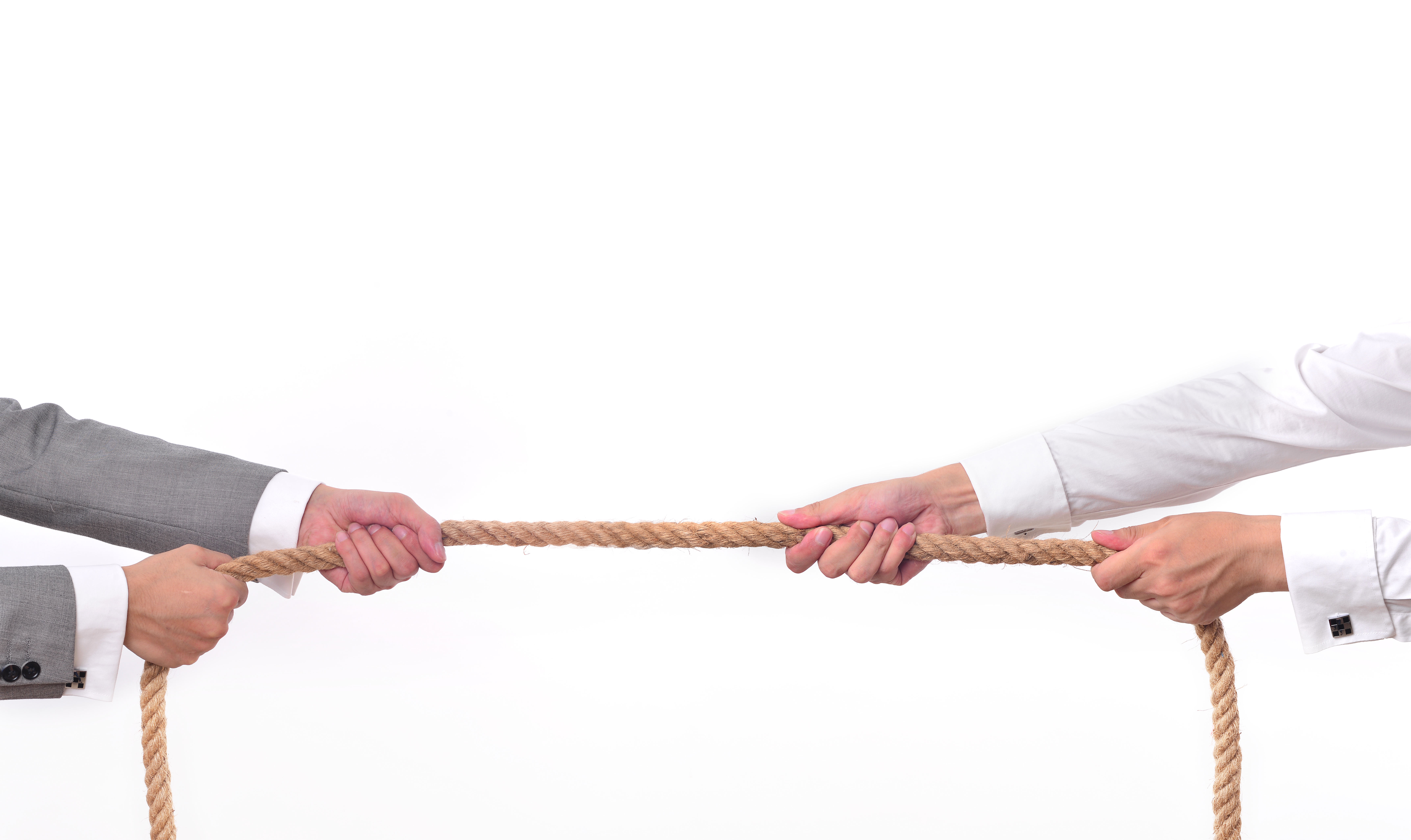 Tug war, two businessman pulling a rope in opposite directions isolated on white background