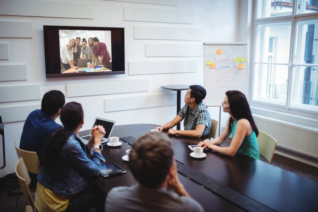 business-executives-doing-a-video-conference_1170-1922