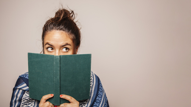girl-holding-book-in-front-of-face_23-2147690566