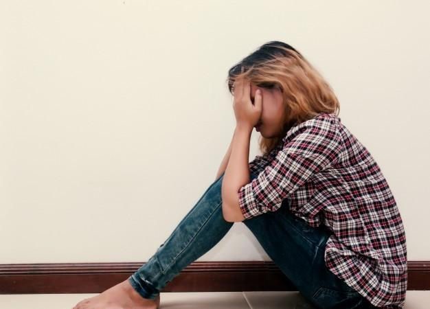 sad-teenager-with-plaid-shirt-crying_1150-396 (1)