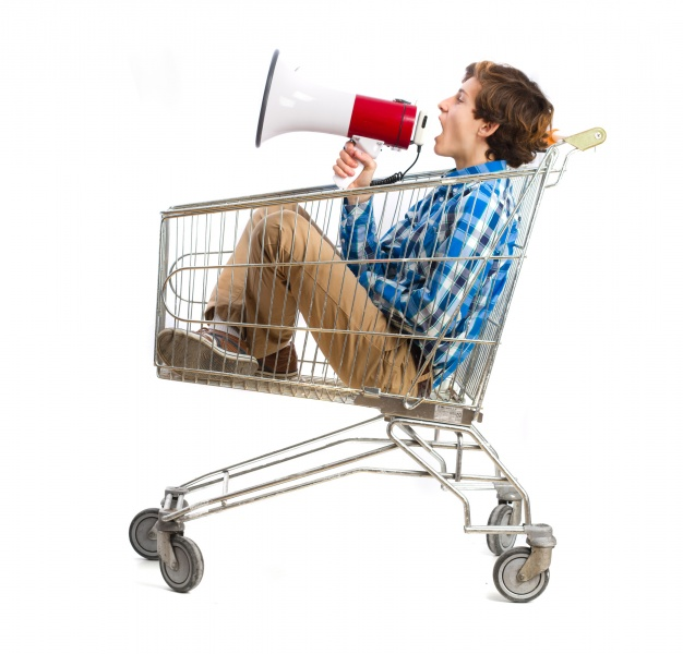 boy-with-a-megaphone-in-a-shopping-cart_1154-37