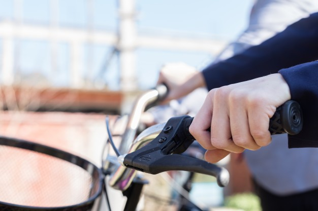 close-up-of-woman-s-hand-next-to-the-bike-brake_23-2147562051