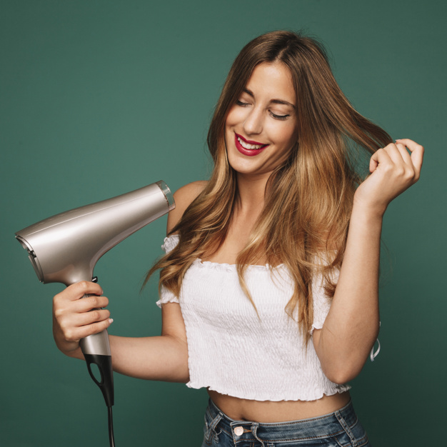 cute-girl-with-hairdryer_23-2147643788