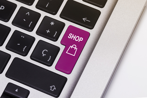"Laptop key showing the word ""shop"", in pink color."