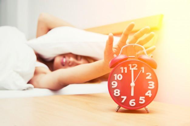 girl-turning-off-the-alarm-clock_1150-184