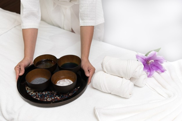 hands-of-happy-woman-holding-spa-facial-face-mask_1357-389