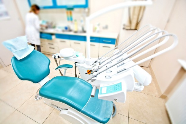 professional-dentist-tools-and-chair-in-the-dental-office_1204-394