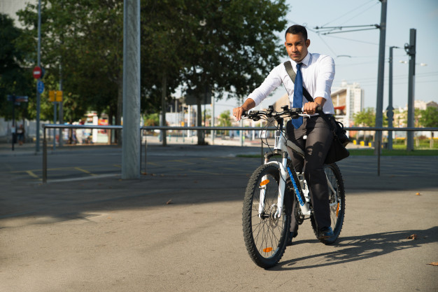 successful-latin-businessman-riding-bike-to-work_1262-6302