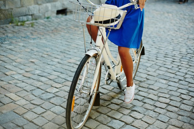 woman-bicycle-skirt-cyclist-activity_1098-6391