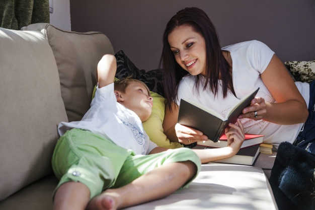 woman-with-son-reading-books_23-2147664123