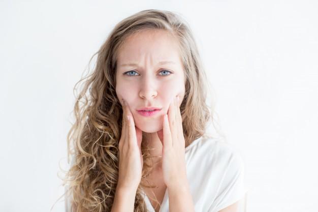 worried-young-beautiful-woman-touching-face_1262-5942