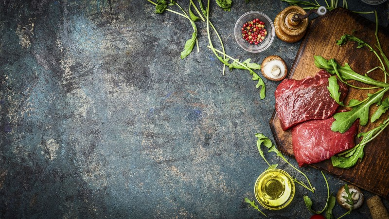 Raw Beef steak and fresh ingredients for cooking, banner.