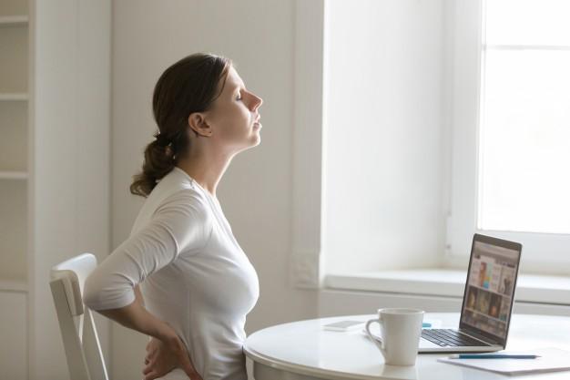 profile-portrait-of-a-woman-at-desk-stretching-backache-positio_1163-2124