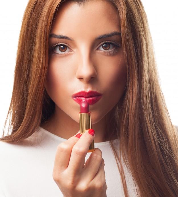 sexy-brunette-applying-red-lipstick_1187-5013