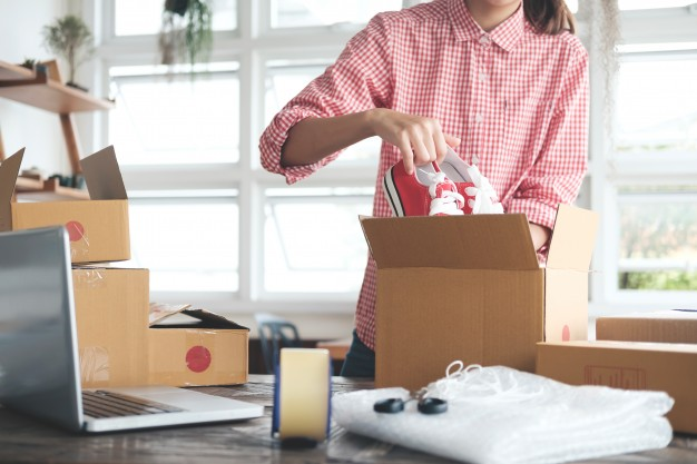 young-startup-entrepreneur-small-business-owner-working-at-home-packaging-and-delivery-situation_1421-1104
