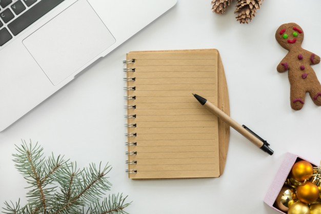 flat-view-of-notebook-in-the-centre-of-christmas-decoration_1163-2774