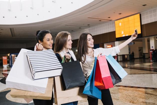 women-taking-selfie-in-mall_23-2147670010
