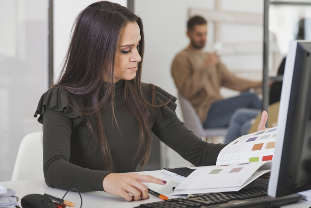 woman-picking-colors-in-office_23-2147727685